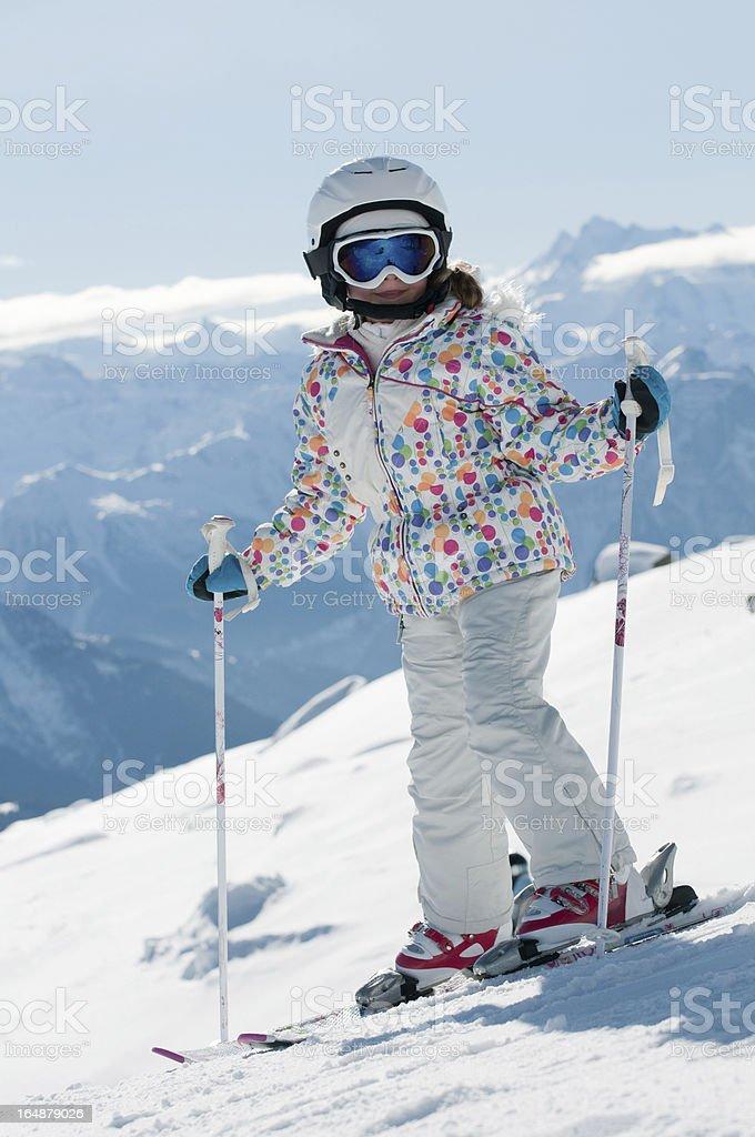 Little skier on ski slope royalty-free stock photo