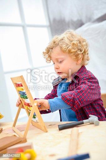 143176157 istock photo Little smart man 864342502