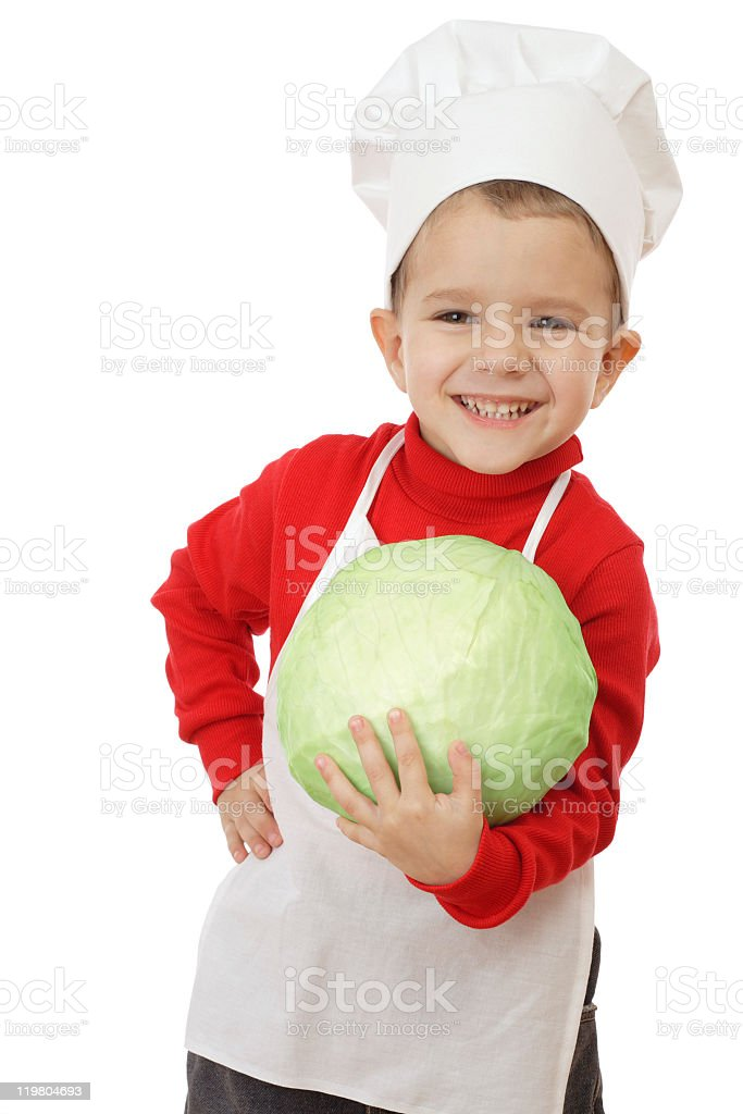 Little smiling chief-cooker with cabbage royalty-free stock photo