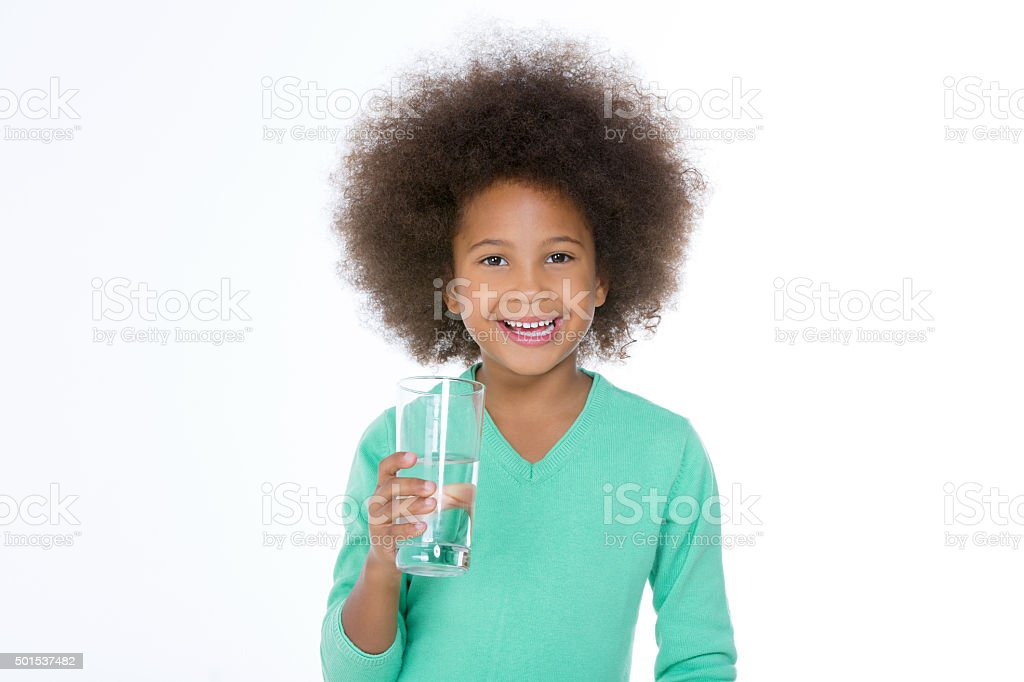 little smiling girl holding a glass stock photo