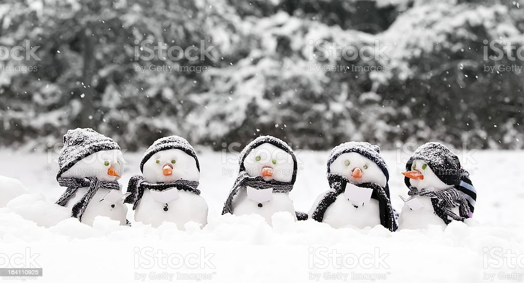 Little snowmen in a group stock photo