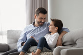 istock Little son having confidence conversation with father at home 1263052889
