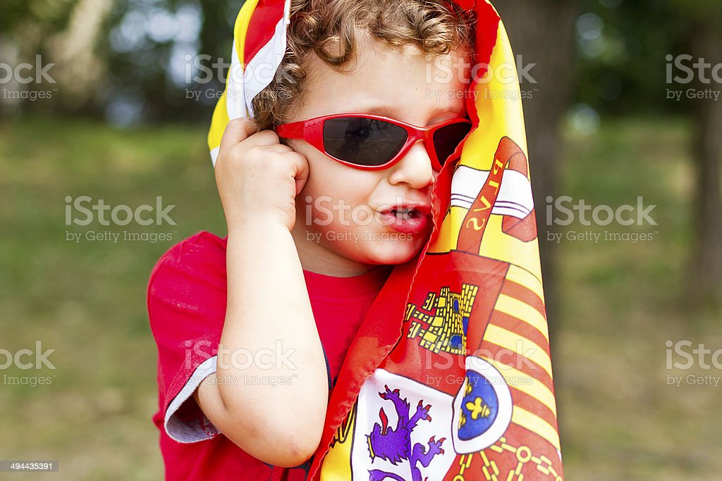 Little spanish supporter with flag on head royalty-free stock photo