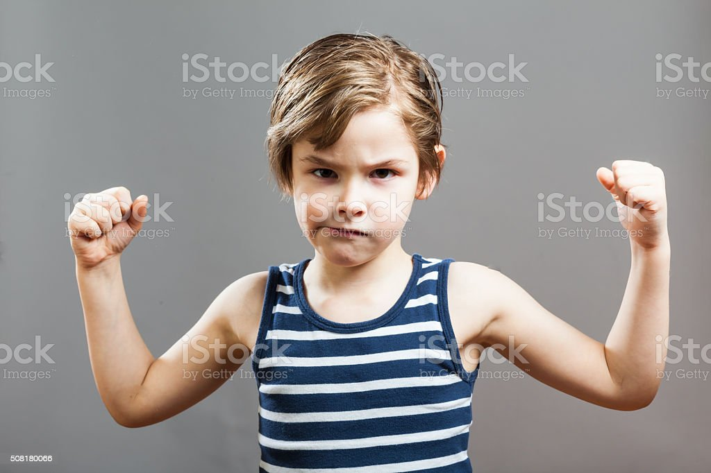Little Sportive Tough Boy, Showing his Muscles stock photo