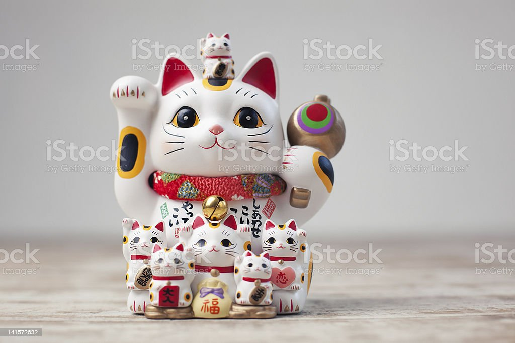 A little statue of a cat that has been exaggerated  stock photo