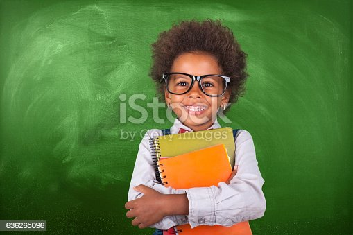 istock Little student girl 636265096