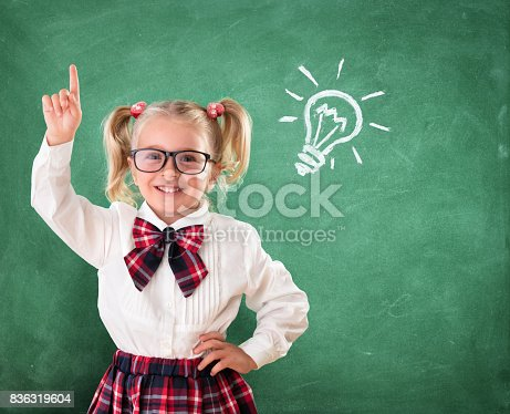 istock Little Student With Idea In Classroom 836319604