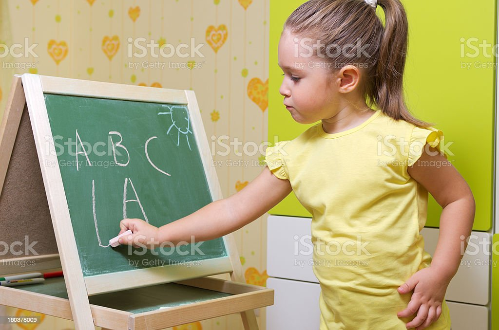 Little studying girl royalty-free stock photo