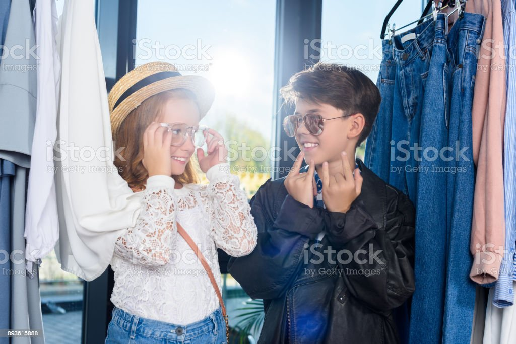 little stylish couple in boutique stock photo