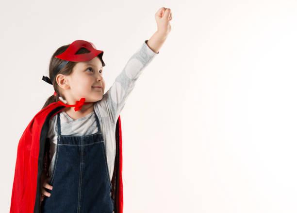 lilla superhjälte flicka - superwoman barn bildbanksfoton och bilder