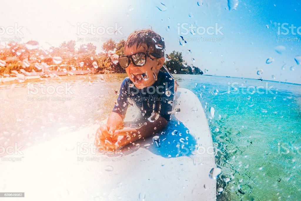 Little surfer boy stock photo