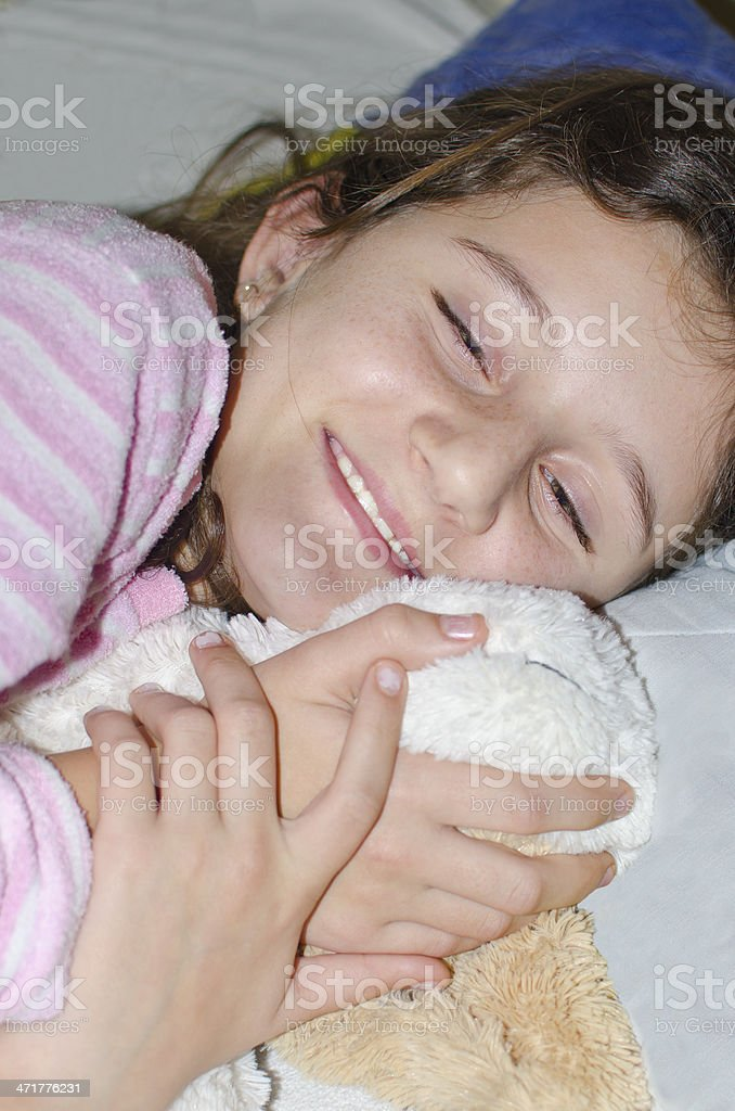Little sweet girl sleeping in bed hugging and holding toy royalty-free stock photo