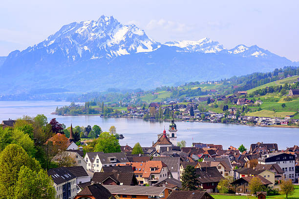 Little swiss town on Lake Lucerne and Pilatus mountain, Switzerland Kussnacht am Rigi old town with Pilatus mountain and Lake Lucerne in background, Switzerland swiss alps stock pictures, royalty-free photos & images