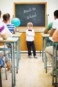 istock Little teacher in his classroom 497853501