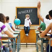 istock Little teacher in his classroom 498089369