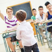 istock Little teacher in his classroom 498212751