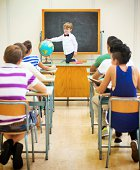 istock Little teacher in his classroom 499227129