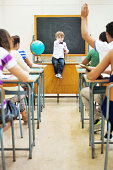 istock Little teacher in his classroom 499227257