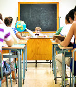 istock Little teacher in his classroom 499227469