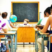 istock Little teacher in his classroom 499257507