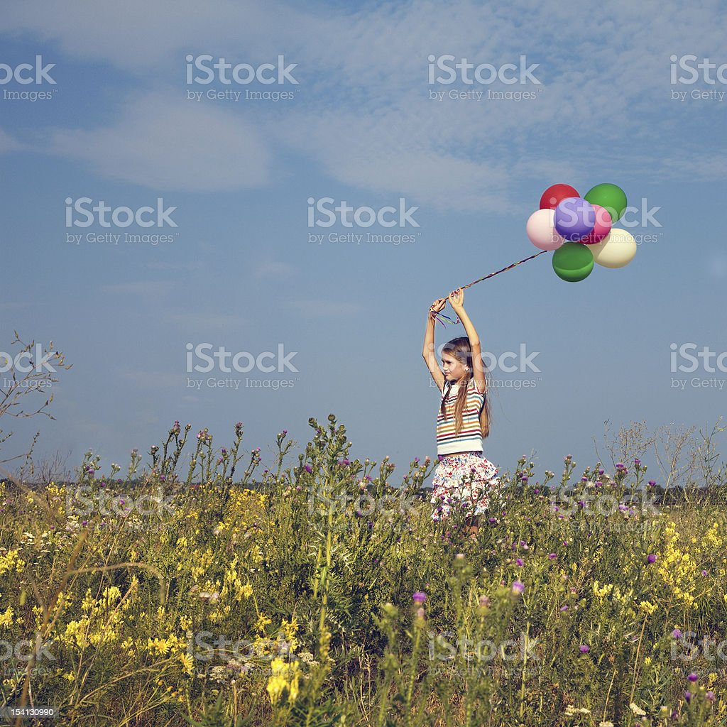 Little teenager child girl with balloons in summer day royalty-free stock photo