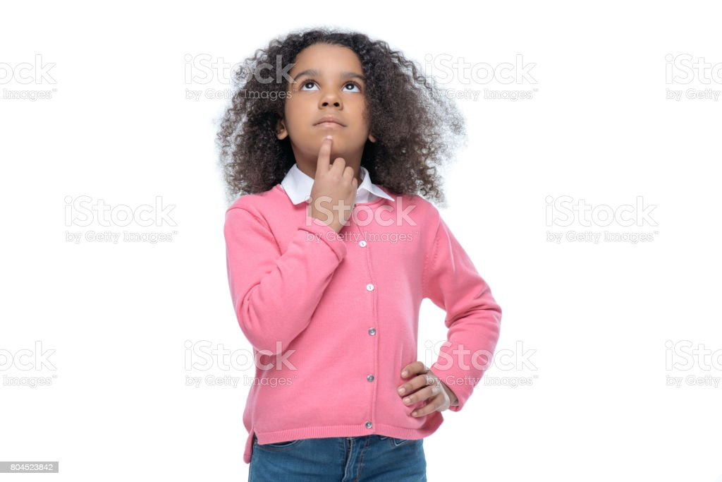 little thoughtful african american girl in pink cardigan isolated on white stock photo