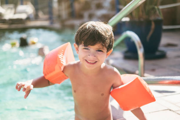 little three years old kid boy with arms float in swimming pool ready to go to water - swim arms imagens e fotografias de stock
