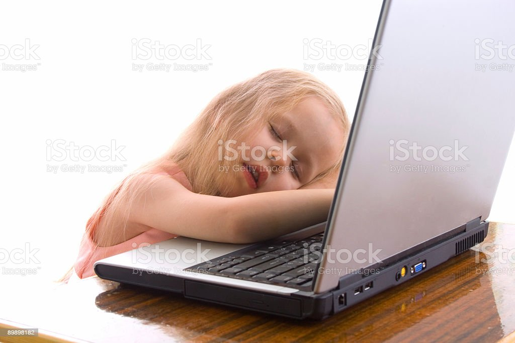 Little tired girl sleep on notebook royalty-free stock photo