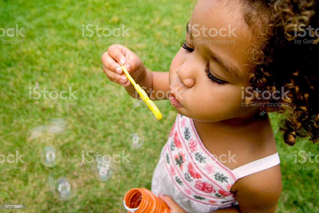 Little Toddler blowing bubbles royalty-free stock photo