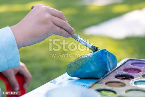 Little Toddler Boy Colorfully Drawing with a Paintbrush
