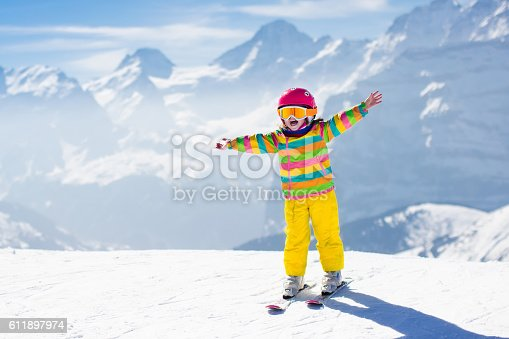 istock Little toddler child skiing in the mountains 611897974