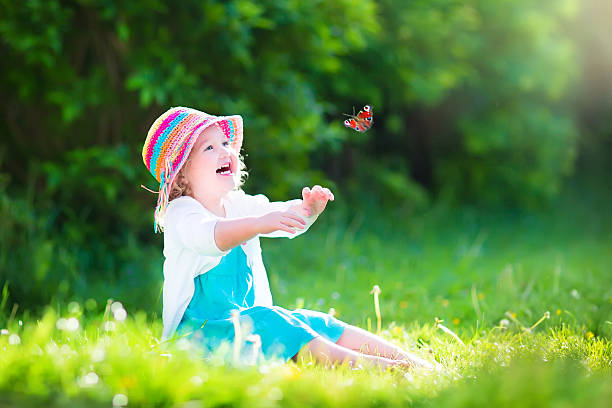 Little toddler girl playing with butterfly picture id491942777?b=1&k=6&m=491942777&s=612x612&w=0&h=16of8yv9fatnzahflbqcve66mv0388d3jorys0wg85q=