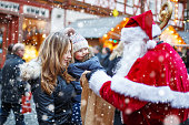 istock Little toddler girl with mother on Christmas market. 585046604