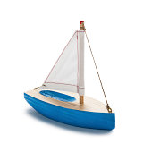 Blue toy sailboat, isolated on white.