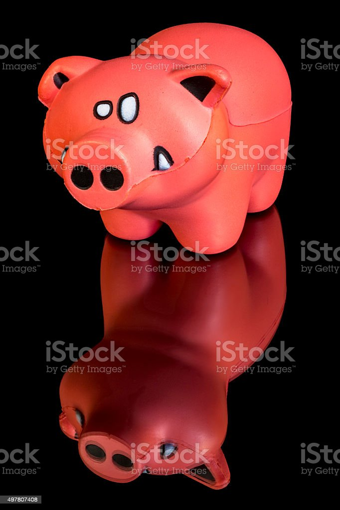 Little toy pig on a reflective table stock photo