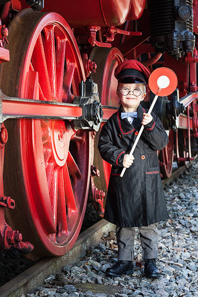 little train conductor boy - transport conductor stock photos and pictures