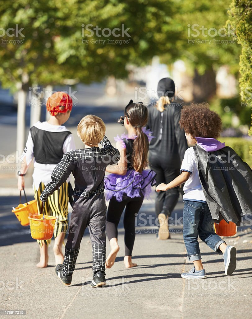 Little trick or treaters stock photo