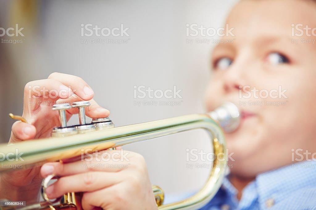 Little trumpeter stock photo