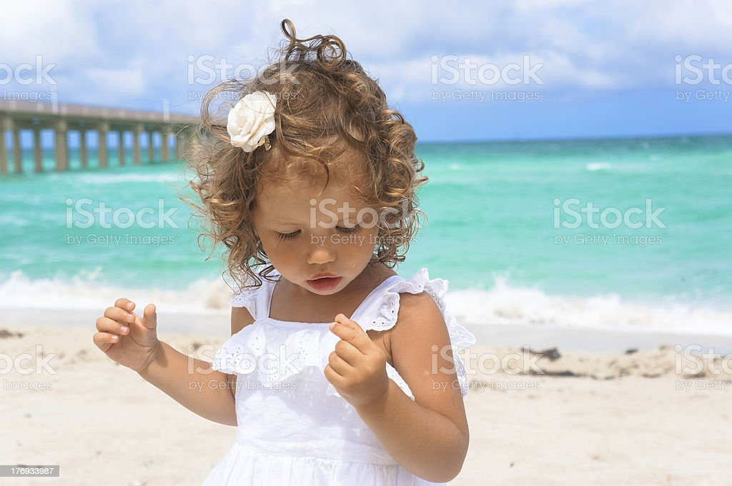 Little two year old girl at the beach royalty-free stock photo