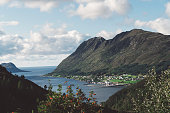 Scenic landscape in Norway. Blue water and mountains surrounding the sea.