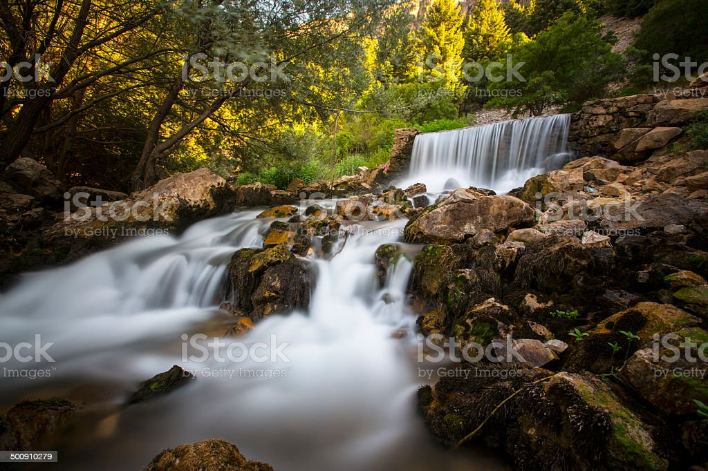 Little waterfall and rock stock photo