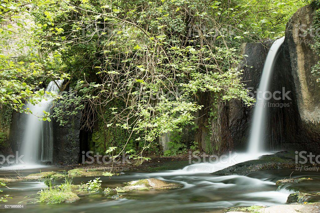 little waterfall in rome stock photo