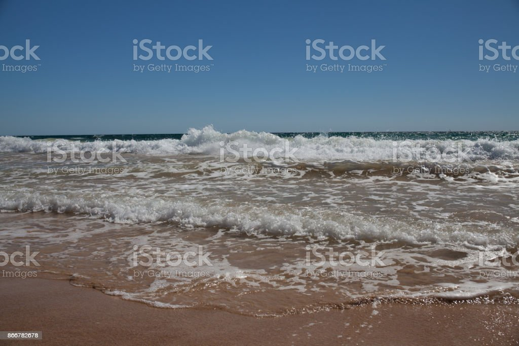 little wave arriving on the beach stock photo