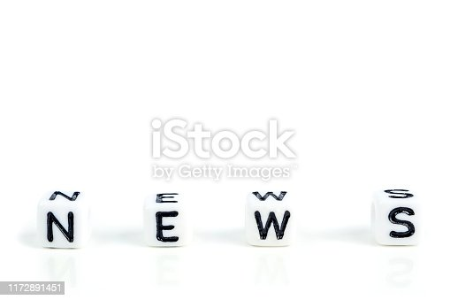 istock little white cubes with black letters of word news on white background 1172891451