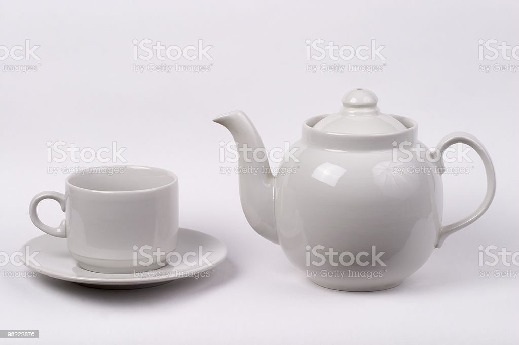 Little white tea cup and a kettle royalty-free stock photo