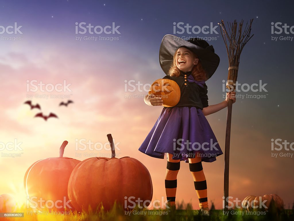 little witch outdoors - foto de stock