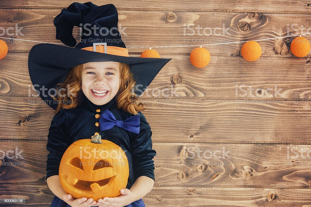little witch with a pumpkin stock photo