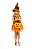 istock Little witch with Halloween bucket 513647167