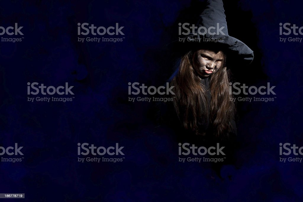 Little witch with halloween pumpkin royalty-free stock photo