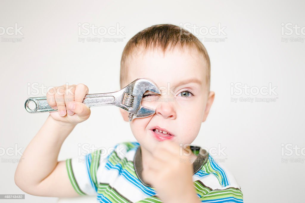 little worker with a wrench stock photo